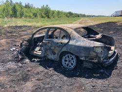'Мерседес' столкнулся с двумя фурами и сгорел, водитель погиб