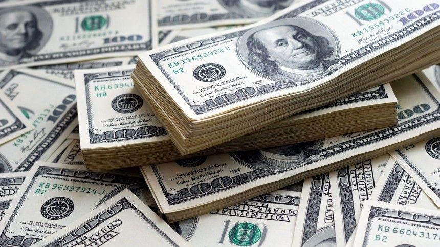Курс доллара на Мосбирже превысил 77 рублей